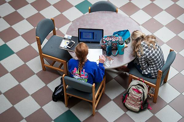 students working at desk from above